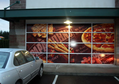 The same window graphics are enlarged for the windows of a second location.