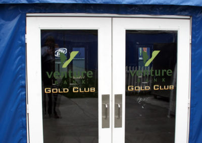 Logo and company name on glass entry doors.