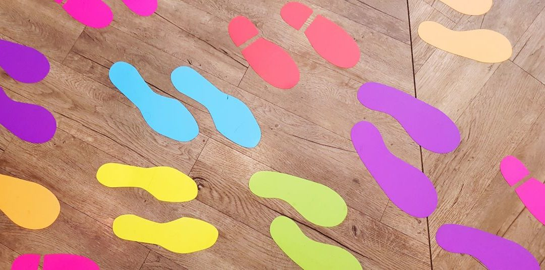 Colored Shoe Prints Stuck to Wood Floor